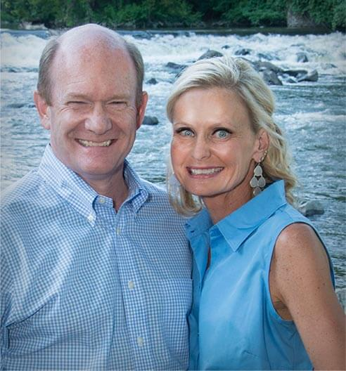 Chris Coons with wife