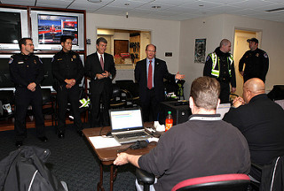 Senators Coons and Blunt deliver home-made cookies to Capitol Police Headquarters in December 2013.